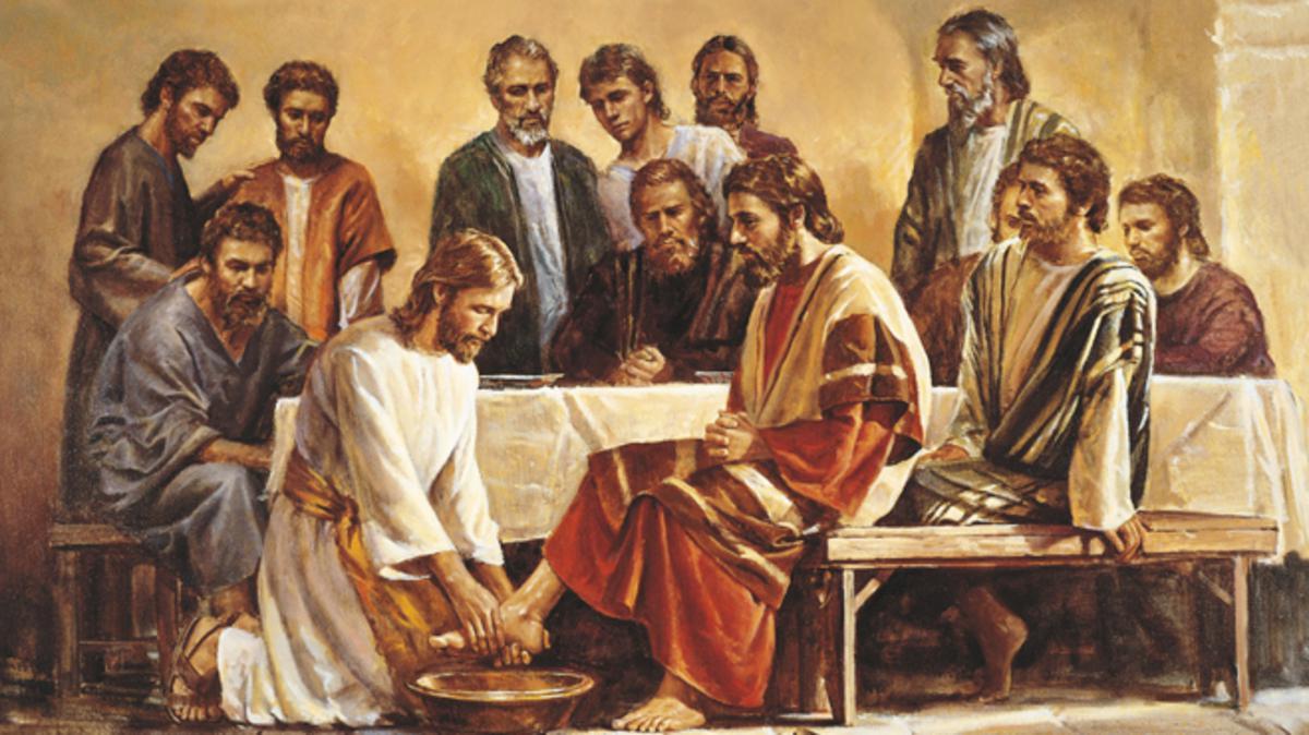 Jesucristo lavando los pies de Sus apóstoles.